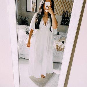 White bohemian deep v bell sleeve wedding dress